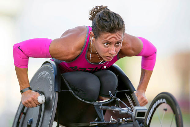 Army Capt. Kelly Elmlinger performs laps in her race wheelchair at Joint Base San Antonio, while training for the 2015 Department of Defense Warrior Games, June 11, 2015. DoD photo by EJ Hersom