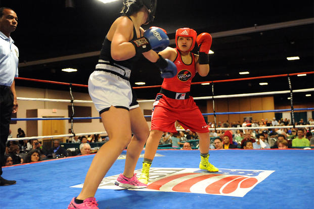 Army Pfc. Rianna Rios, in red, of Fort Carson, Colorado, fights Katina Melendrez in the women's open 132-pound division finale of the 2015 Colorado Golden Gloves Championships at the Crown Plaza Convention Center, March 27, 2015. U.S. Army photo/Tim Hipp