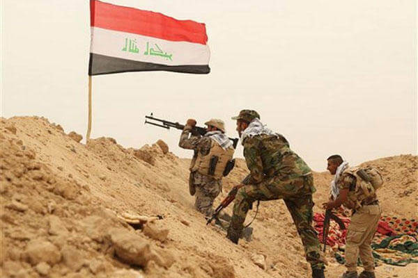 Fighters from the Badr Brigades Shiite militia clash with Islamic State militant group at the front line, on the outskirts of Fallujah, Anbar province, Iraq, Monday, June 1, 2015. (AP Photo/Hadi Mizban)