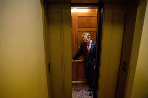 Republican presidential candidate, Sen. Rand Paul, R-Ky. departs in an elevator after speaking at a news conference on Capitol Hill, June 2, 2015, calling for the 28 classified pages of the 9-11 report to be declassified. (AP Photo/Andrew Harnik)