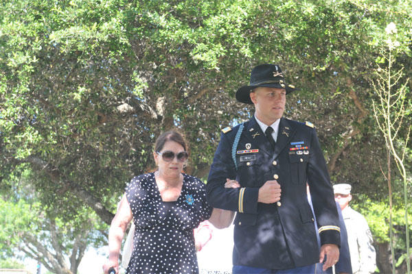 "Susan Rescorla, wife of Col. (Ret.) Cyril Richard ""Rick"" Rescorla and 1st Lt. Ross Reid , a Cardiff, Wales, native, walk toward the ceremony dedicated to Rescorla June 11 at Fort Hood, Texas. (U.S. Army photo by Sgt. Brandon Banzhaf)"