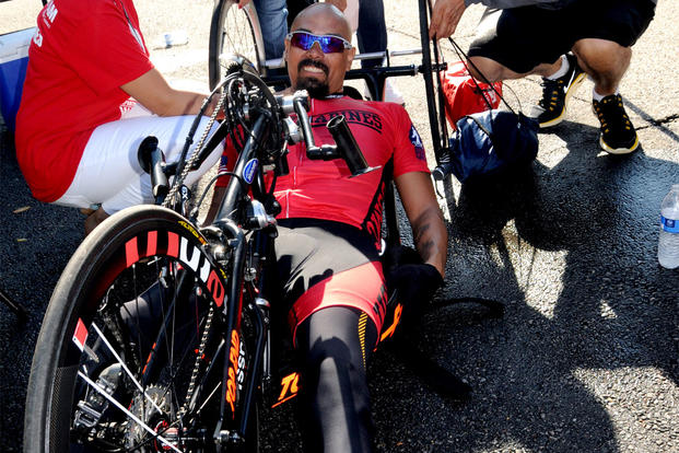 Medically retired Marine Corps Staff Sgt. Ronnie Jeffrey Jimenez celebrates after he earned a gold medal in the men's H5 hand cycle category at the 2015 DoD Warrior Games on Marine Corps Base Quantico, Va., June 21, 2015. DoD photo by Shannon Collins