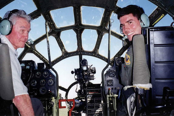"Retired Brig. Gen. Paul Tibbets Jr. (left) and his grandson, Col. Paul Tibbets IV, then a captain, fly the last flyable B-29 Superfortress, ""Fifi,: Oct. 2, 1998, in Midland, Texas. Courtesy Photo"