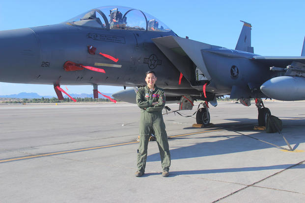 Capt. Kari Armstrong, an F-15E Strike Eagle weapon systems officer with the 389th Fighter Squadron, received a diploma from the U.S. Air Force Weapons School at Nellis Air Force Base, June 27, 2015. (U.S. Air Force/Courtesy photo/Susan Garcia)