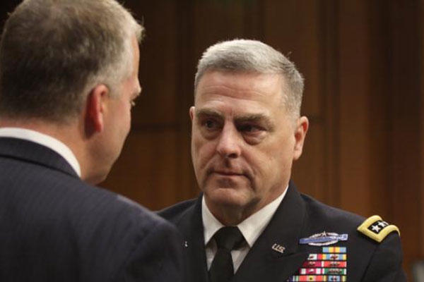 Gen. Mark Milley talks with Sen. Dan Sullivan, R-AK, after Milley's confirmation hearing at the Senate Armed Services Committee on July 21, 2015 on Capitol Hill in Washington. (AP Photo/Lauren Victoria Burke)