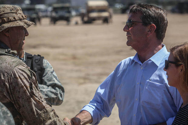 U.S. Secretary of Defense, the honorable Mr. Ashton Carter congratulates a young reconnaissance Marine on a job well done following a combined arms raid aboard Marine Corps Base Camp Pendleton, Calif., Aug. 27, 2015. (Photo: Cpl. Seth Starr)