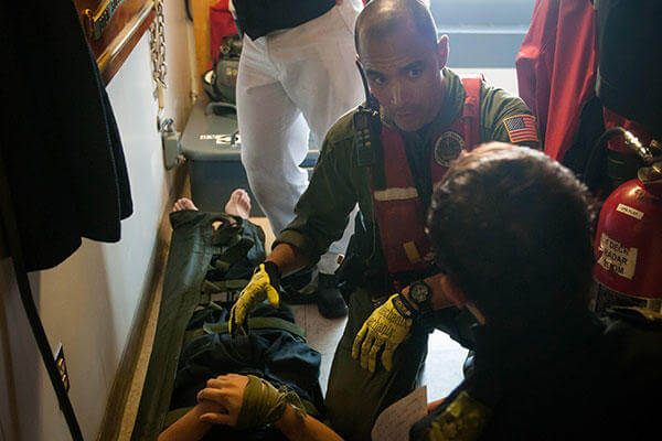 Petty Officer 2nd Class Mario Estevane on board the Canadian Warship HMCS Summerside for a mock medical evacuation. ( (U.S. Coast Guard/PO 3rd Class Ross Ruddell)