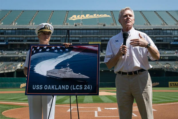 Secretary of the Navy Ray Mabus announces the name of the Independence-class littoral combat ship LCS 24 as USS Oakland during a major league baseball game. (U.S. Navy photo by Mass Communication Specialist 2nd Class Armando Gonzales/Released)