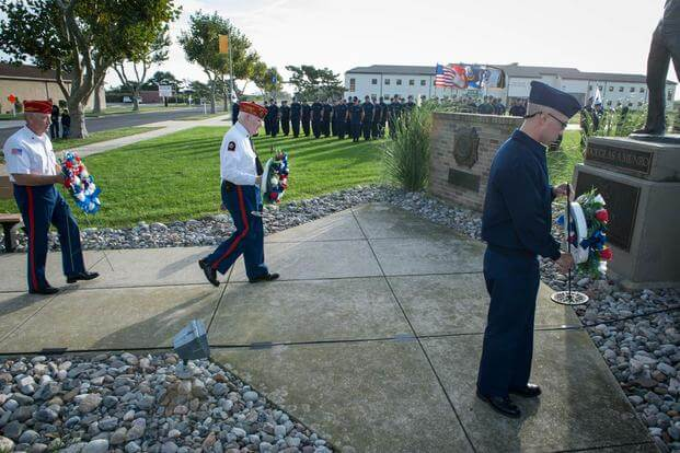 Members of the Marine Corps League Dramis Detachment and a Coast Guard recruit prepare to place wreaths at the foot of the Douglas Munro Memorial, Sunday, Sept. 27, 2015. (Photo by Chief Warrant Officer John Edwards)