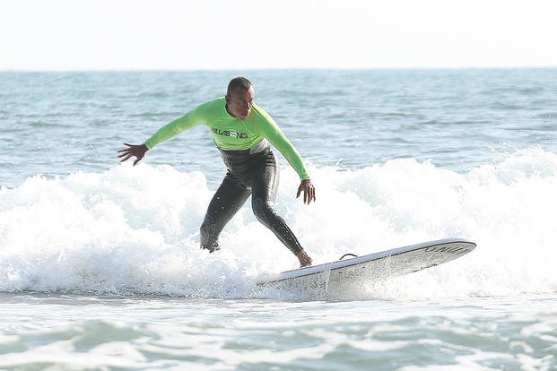 Marine Corps Master Sgt. Hugo L. Gonzalez surfs with Operation Amped at San Onofre Beach, Calif., Aug. 21, 2015. (U.S. Marine Corps photo by Cpl. Asia J. Sorenson)