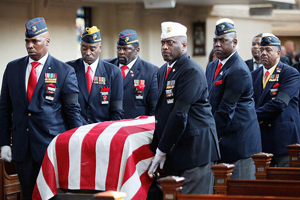 Members of the Montford Point Marine Association carry the casket of Lt. Gen. Frank E. Petersen, Jr. (ret.) during his memorial service. (U.S. Marines/Sgt. Terry Brady)