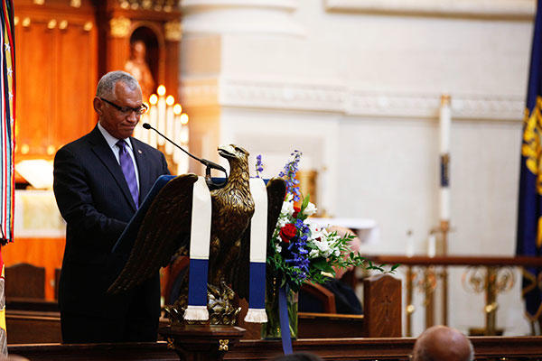 Maj. Gen. Charles F. Bolden (ret.), Administrator of NASA, speaks about Lt. Gen. Frank E. Petersen, Jr. (ret.) during a memorial service at the U.S. Naval Academy. (U.S. Marines/Sgt. Terry Brady)