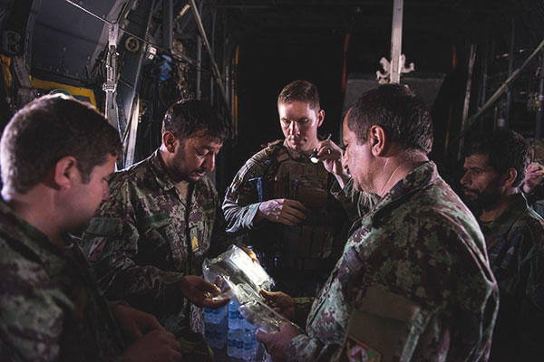 U.S. Air Force Master Sgt. Michael Doane and Afghan airmen complete an AFE inspection during a training session with U.S. Airmen. (U.S. Air Force /Tech. Sgt. Joseph Swafford)