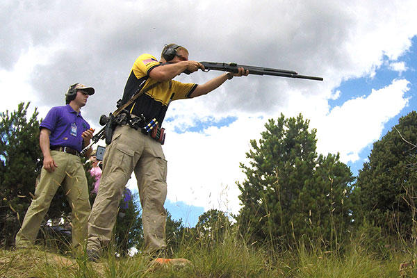 Sgt. Joel Turner fires at a target during the 2015 Rocky Mountain 3-Gun Championship. (U.S. Army/Brenda Rolin)