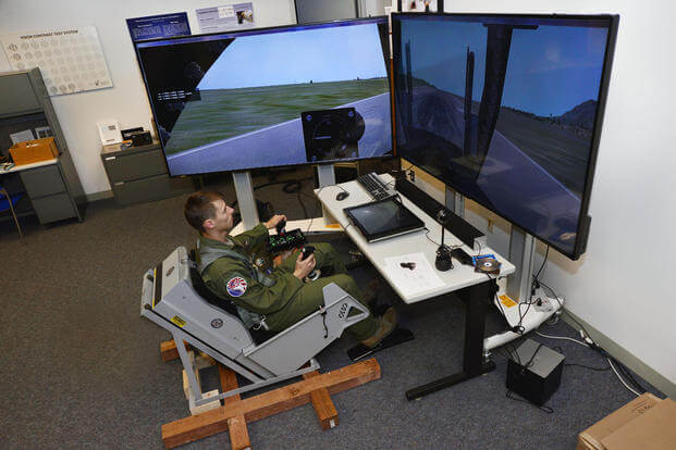 Cadet 1st Class Cody Haggin tests a dynamic motion seat in the Warfighter Effective Research Center at the U.S. Air Force Academy Oct. 23, 2015. (U.S. Air Force Photo/Bill Evans)