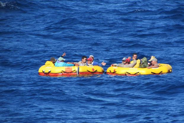 Twelve Cuban migrants drift aboard two life rafts provided by a Coast Guard aircraft that located the migrants aboard a partially submerged migrant vessel 100 miles southwest of Key West, Florida, Dec. 17, 2015. (U.S. Coast Guard photo)