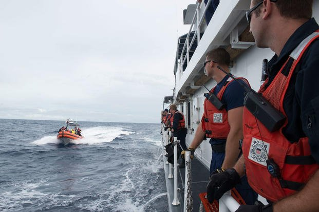 Crewmembers aboard the Coast Guard Cutter Kathleen Moore prepare to receive Cuban nationals interdicted in the Florida Straits, Dec. 7, 2015. (Photo: Petty Officer 3rd Class Ashley J. Johnson)