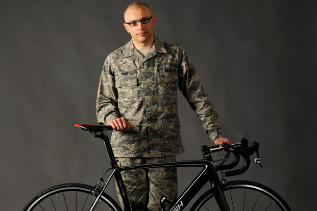 Tech. Sgt. Dwayne Farr, assigned to the Oregon Air National Guard's 142nd Aircraft Maintenance Squadron, poses with one of his bicycles on Portland Air National Guard Base, Ore., April 7, 2013. (U.S. Air National Guard photo/Tech. Sgt. John Hughel)