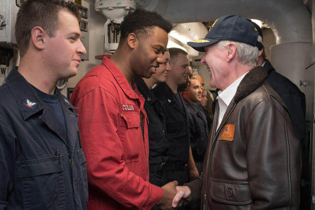 Secretary of the Navy Ray Mabusgreets Sailors assigned to the guided-missile destroyer USS William P. Lawrence before eating lunch with them on the ship's mess decks. (Photo: Mass Communication Specialist 2nd Class Armando Gonzales)