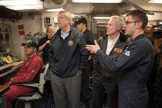 Secretary of the Navy Ray Mabus, center right, and Secretary of Agriculture Tom Vilsack, center left, tour the guided-missile destroyer USS William P. Lawrence. (Photo: Mass Communication Specialist 2nd Class Armando Gonzales)