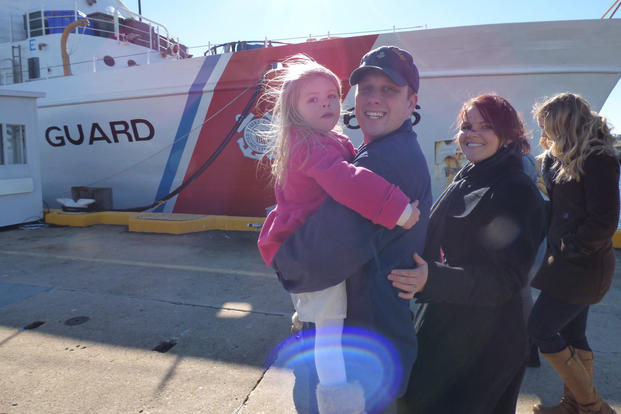 Petty Officer 1st Class Roger Sharp reunites with his family during the Dependable's return to homeport in Virginia Beach, Va., Jan. 14, 2016.  (Photo: Senior Chief Petty Officer Sarah B. Foster)