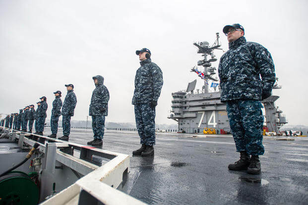 Sailors man the rails on USS John C. Stennis' (CVN 74) flight deck as the ship gets underway for a regularly scheduled deployment. (Photo: Mass Communication Specialist 3rd Class Andre T. Richard)