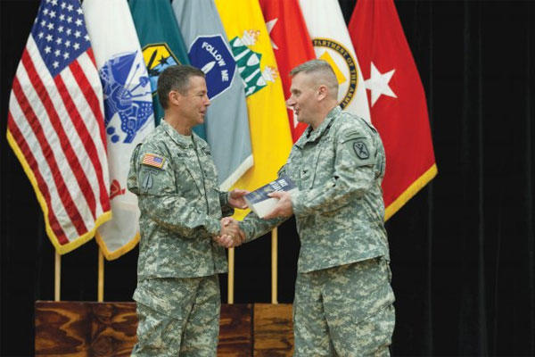 Maneuver Center of Excellence Commanding General Maj. Gen. Scott Miller, left, congratulates and presents a gift to Col. John Marr during Marr's retirement ceremony Sept. 5, 2014 at Derby Auditorium. (U.S. Army photo)