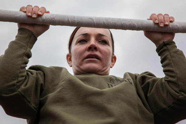 Major Misty Posey demonstrates proper form for pull-ups to Marines at Marine Corps Base Quantico, Virginia, Feb. 19, 2016. (Photo: Sgt. Dylan Bowyer)