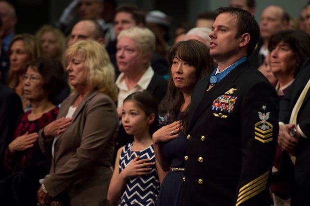 Navy Senior Chief Petty Officer Edward C. Byers Jr., a Medal of Honor recipient, stands with his family during a ceremony to induct him into the Hall of Heroes at the Pentagon March 1, 2016. (Photo: Air Force Senior Master Sgt. Adrian Cadiz)