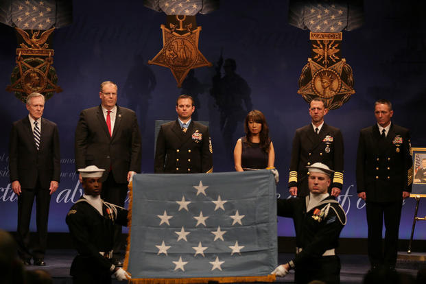 Members of the U.S. Navy Ceremonial Guard display the Medal of Honor flag during a Hall of Heroes induction ceremony for Edward C. Byers Jr. (U.S. Navy photo by Oscar Sosa/Released)