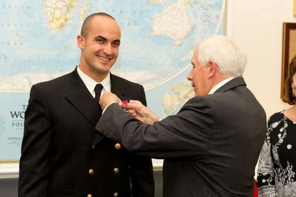 Former Navy Lt. James Zumwalt, left, here having the Bronze Star pinned on by Rep. Frank Wolfe, R-Virginia, in 2012.