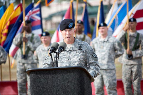 "Outgoing 25th Infantry Division Deputy Commanding General-Operations Brig. Gen. Bryan Fenton, addresses the division during a ""Flying V"" ceremony June 16, 2015 on Schofield Barracks. (U.S. Army photo/Staff Sgt. Tramel S Garrett)"