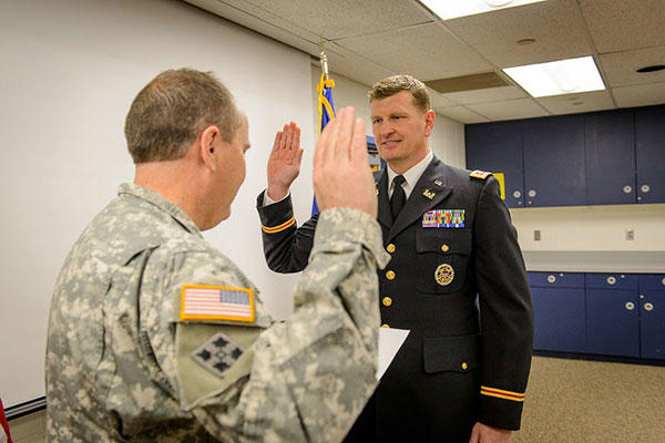 Col. Leo Ryan, left, administers the oath of office to newly-promoted Lt. Col. Brock Larson during a ceremony Jan. 9, 2015. (U.S. Army National Guard photo by Staff Sgt. Brett Miller, Joint Force Headquarters)