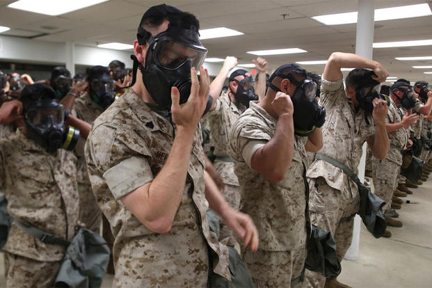 Marines and Sailors with Chemical Biological Incident Response Force unit participated in an all hands on gas mask drill on June 7. 2016. at the Naval Support Facility Indian Head, Md. (Photo: Staff Sgt. Santiago G. Colon Jr.)