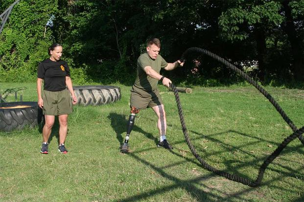 Master Sgt. Berle Sigman, a student in the Faculty Advisors Course at the Quantico Staff Non-Commissioned Officer Academy, completes a physical training session with Master Gunnery Sgt. Amber Hecht, a lead instructor in the FAC. (Courtesy photo)