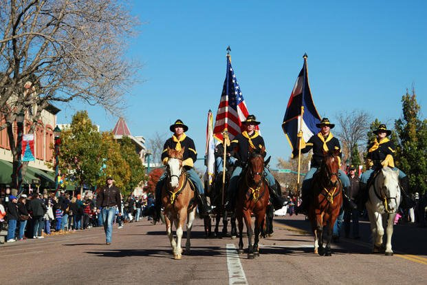 The Fort Carson Mounted Color Guard marches at the head of the Colorado Springs Veterans Day Parade, Nov. 7, 2015. (U.S. Army/William Howard)