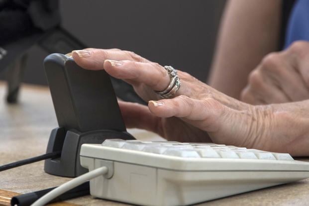 Arlene Wagner, Gold Star mother, places her finger on a scanner for a Gold Star Base Access ID card at Joint Base Andrews, Md., May 1, 2017. (U.S. Air Force photo/Senior Airman Jordyn Fetter)