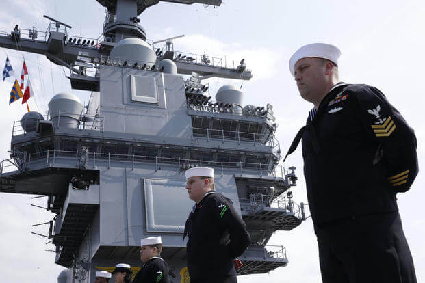 Pre-Commissioning Unit Gerald R. Ford (CVN 78) sailors man the rails as the ship returns to Norfolk after conducting builder's sea trials, April 14, 2017. (U.S. Navy photo/Mass Communication 3rd Class Matthew R. Fairchild)