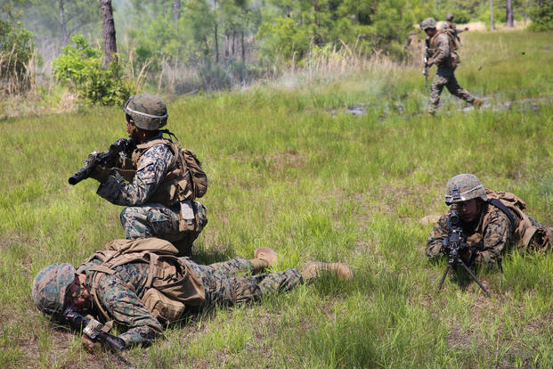 Marines provides security while waiting to safely evacuate an injured Marine after a simulated Improvised Explosive Device explosion during a field training exercise at Camp Lejeune, N.C., May 3, 2017. (U.S. Marine Corps photo/Lance Cpl. Patrick Osino)