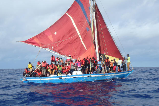 The Coast Guard Cutter Mohawk crew interdicts a group of Haitian migrants July 11, 2017, approximately 22 miles south of Great Inagua, Bahamas. (U.S. Coast Guard photo)