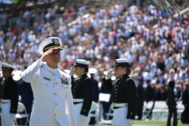 Coast Guard Commandant Adm. Paul Zukunft departs the stage following the 136th Coast Guard Academy commencement exercise in New London, Conn., May 17, 2017. (Coast Guard photo/Petty Officer 2nd Class Patrick Kelley)