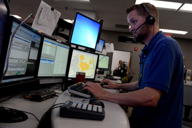 Jason Solomon, a Navy Region Southeast 911 emergency dispatcher, works at his multiscreen station in the Navy Region Southeast Regional Dispatch Center, April 12, 2017. (U.S. Navy photo/Mass Communication Specialist 1st Class Stacy D. Laseter)