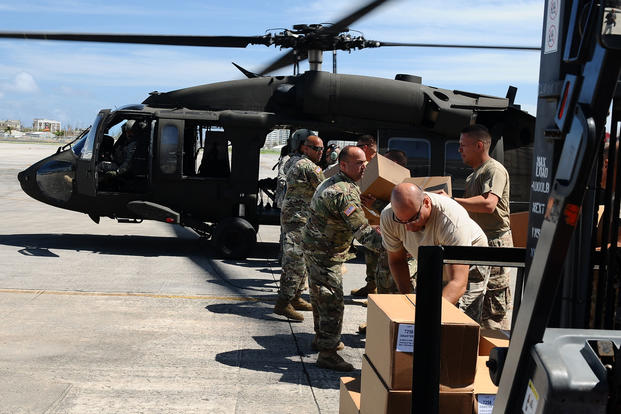Citizen-Soldiers from the Puerto Rico National Guard Army Aviation Support Facility distributed water and food to the community of Orocovis, Sept. 29, 2017. (Photo by Sgt. José Ahiram Díaz-Ramos, PRNG-PAO)