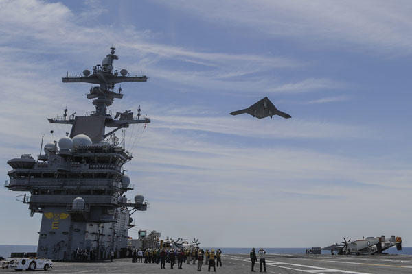 The X-47B launches from a carrier.
