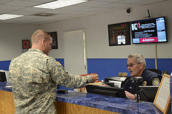 A new DoD background check system will end open access policies at some bases and instead require visitors without DoD ID cards to receive a special pass.
