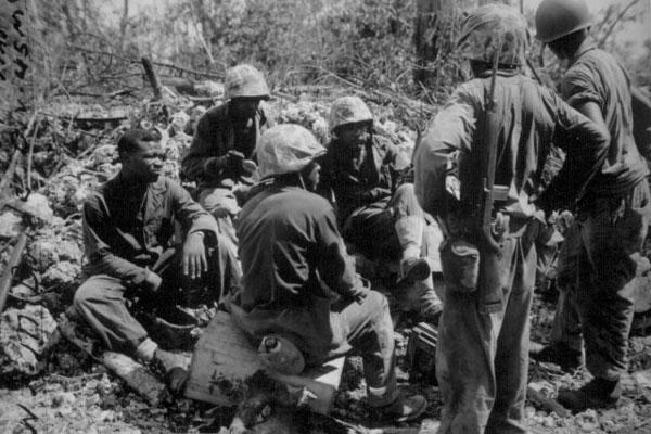 Group of CBs acting as stretcher bearers for the 7th Marines. Peleliu. September 1944. Sgt. McBride
