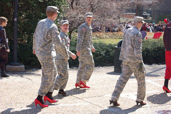 Captions: Cadets wear red heels in support of an event for sexual assault awareness called Walk a Mile in Her Shoes. (Source: Temple ROTC Facebook page)