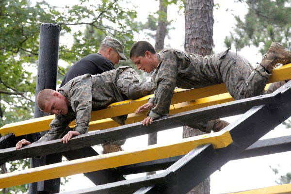 U.S. Army soldiers participate in the Darby Queen obstacle course as part of their training at the Ranger School at Ft. Benning Ga., June 28, 2015. Army Photo.