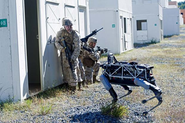 Spot, a quadruped prototype robot, aids Marines in clearing a room during a demonstration at Marine Corps Base Quantico, Va., Sept. 16, 2015. Photo By: Sgt. Eric Keenan