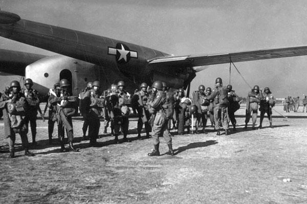 Members of the 555th Parachute Infantry Battalion, or 'Triple Nickels,' are briefed before takeoff from Fort Dix, N.J., in this file photo from 1947. (National Archives)